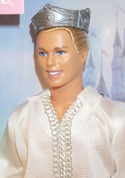ken dressed up as a prince barbie and ken doll